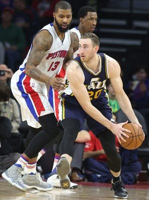 Pistons forward Marcus Morris defends against Jazz guard Gordon Hayward during the third period Wednesday at The Palace of Auburn Hills.