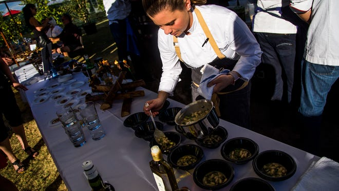 Chef Rochelle Daniel puts the finishing touches on a dish for Scotch, Steaks & Stogies at azcentral.com Food and Wine Experience on Nov. 5, 2016, at Salt River Fields at Talking Stick.