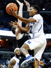 Memphis guard Jeremiah Martin drives for a layup against the Tulane defense during first half action at the FedExForum in Memphis Tenn., Tuesday, January 9, 2017.