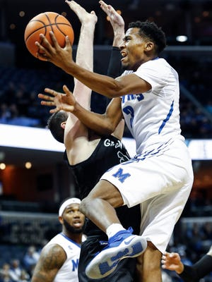 Memphis guard Jeremiah Martin drives for a layup against the Tulane defense.