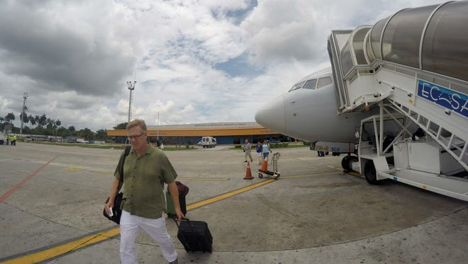 A passenger walks June 10, 2016, to his American Airlines charter flight to Miami at Havana''s Jose Marti International Airport.