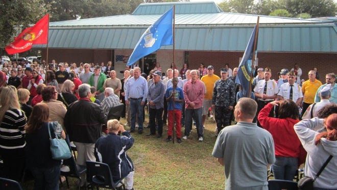 Apollo Elementary honored veterans Monday through music, presentation of colors and a salute to the U.S. military in its 34th annual Veterans Day event.