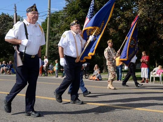 Members of the VFW march at the front of the parade.