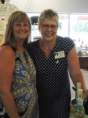 Jill Lokay, Domino's foster mom, and Mallo Bisset, secretary/treasurer of Domino's, at the Sip and Shop hosted by Cory's Furniture Collection Resale Shop to benefit Domino's Cat Rescue League.