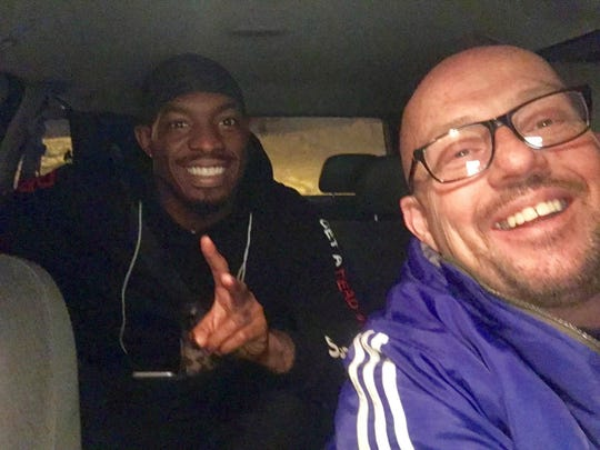 Uber driver Kevin Plekan, right, and Green Bay Packers Safety Ha Ha Clinton-Dix pose for a photo after Plekan drove Clinton-Dix to a grocery store during the blizzard on Sunday.