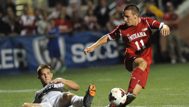 FILE – Butler's Brandon Fricke stops a scoring attempt by Indiana's Tanner Thompson in the second half during the 2013 match between the in-state rivals.