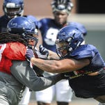 Ole Miss' Justin Bell, left, blocks defensive lineman Robert Nkemdiche during practice. The Ole Miss offensive and defensive lines will be a focus early in the season to see if they can establish themselves at the line of scrimmage.