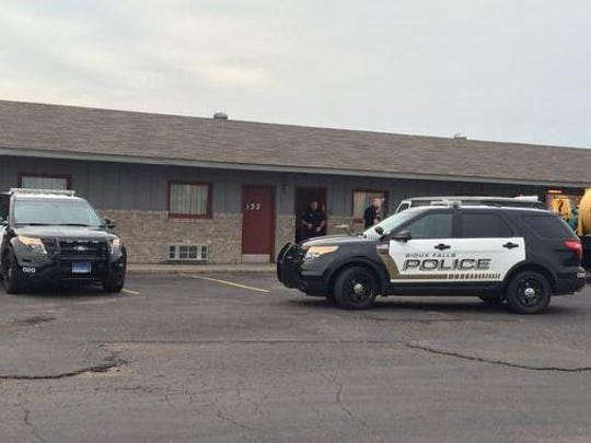 Police investigate an armed robbery at Cloud 9 Motel on North Cliff Avenue on Tuesday morning.