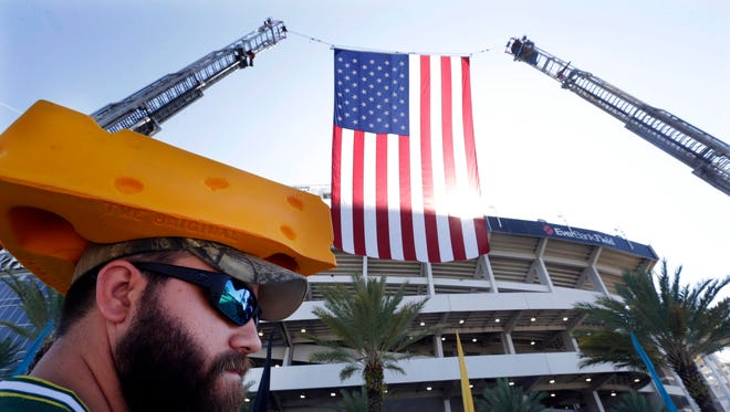 Cody Bennington, Miami Florida shows of his cheesehead while viewing a 9/11 memorial before the season NFL football opener  between the Green Bay Packers and the Jacksonville Jaguars.