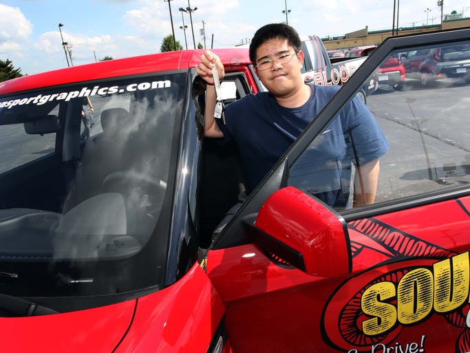Images of the Youngblood Kia car giveaway in Springfield on May 22, 2014.