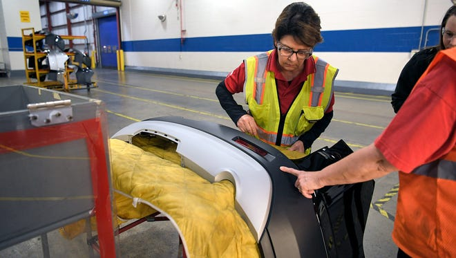 Cathy Busbee, left, looks at a new bumper with team member Lori Carriott on Feb. 14, 2018, at the General Motors plant in Spring Hill. Busbee joined the Spring Hill plant in 1990 after losing her job at a GM plant in Michigan.