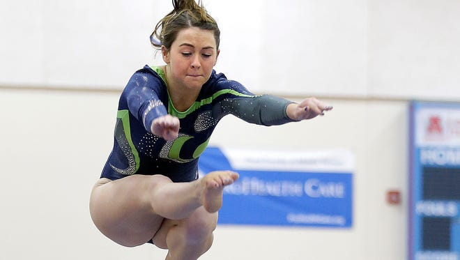 Whitefish Bay's Aly Yurkowitz competes on the beam during a gymnastics meet last January.