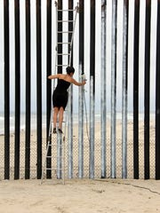 Ana Teresa Fernández painted the border fence in Tijuana
