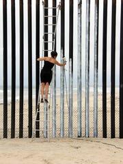 Ana Teresa Fernández painted the border fence in Tijuana