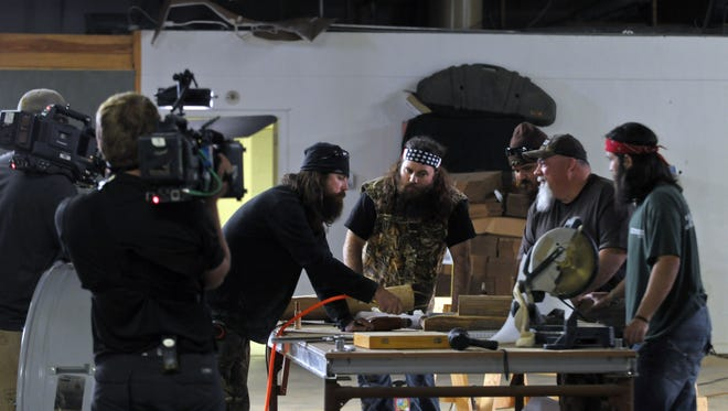 """A&E's hit reality show, """"Duck Dynasty"""" is about a family -- the Robertsons -- that made a fortune making duck calls. Shown are Jase Robertson, left, Willie Robertson, Justin Martin, John Godwin and Jep Robertson. Jase will be at Books-A-Million at the Avenue in Viera on Sunday to sign books."""