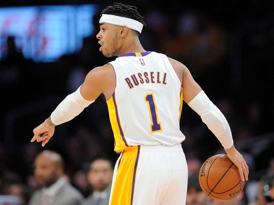 Los Angeles Lakers guard D'Angelo Russell (1) controls the ball against the Detroit Pistons during the first half at Staples Center.