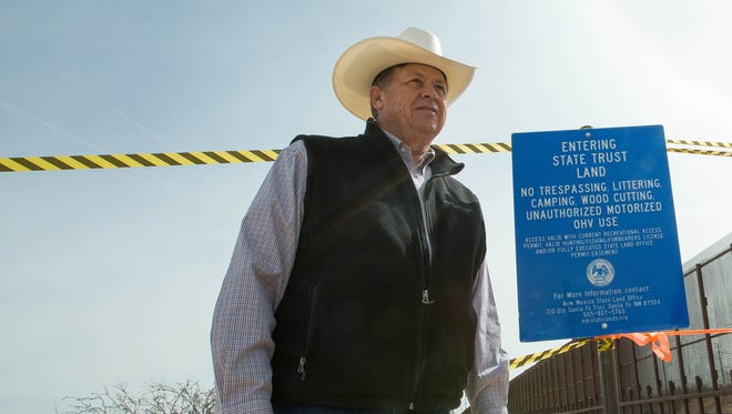 "Aubrey Dunn, New Mexico land commissioner and U.S. Senate candidate, installs a ""No Trespassing"" sign on a parcel of land on the U.S.-Mexico border near the Santa Teresa Port of Entry on Tuesday, March 6, 2018. Dunn says the one-mile tract of land is owned by state and that the Border Patrol — which uses that land to patrol the border — doesn't have the right of way."