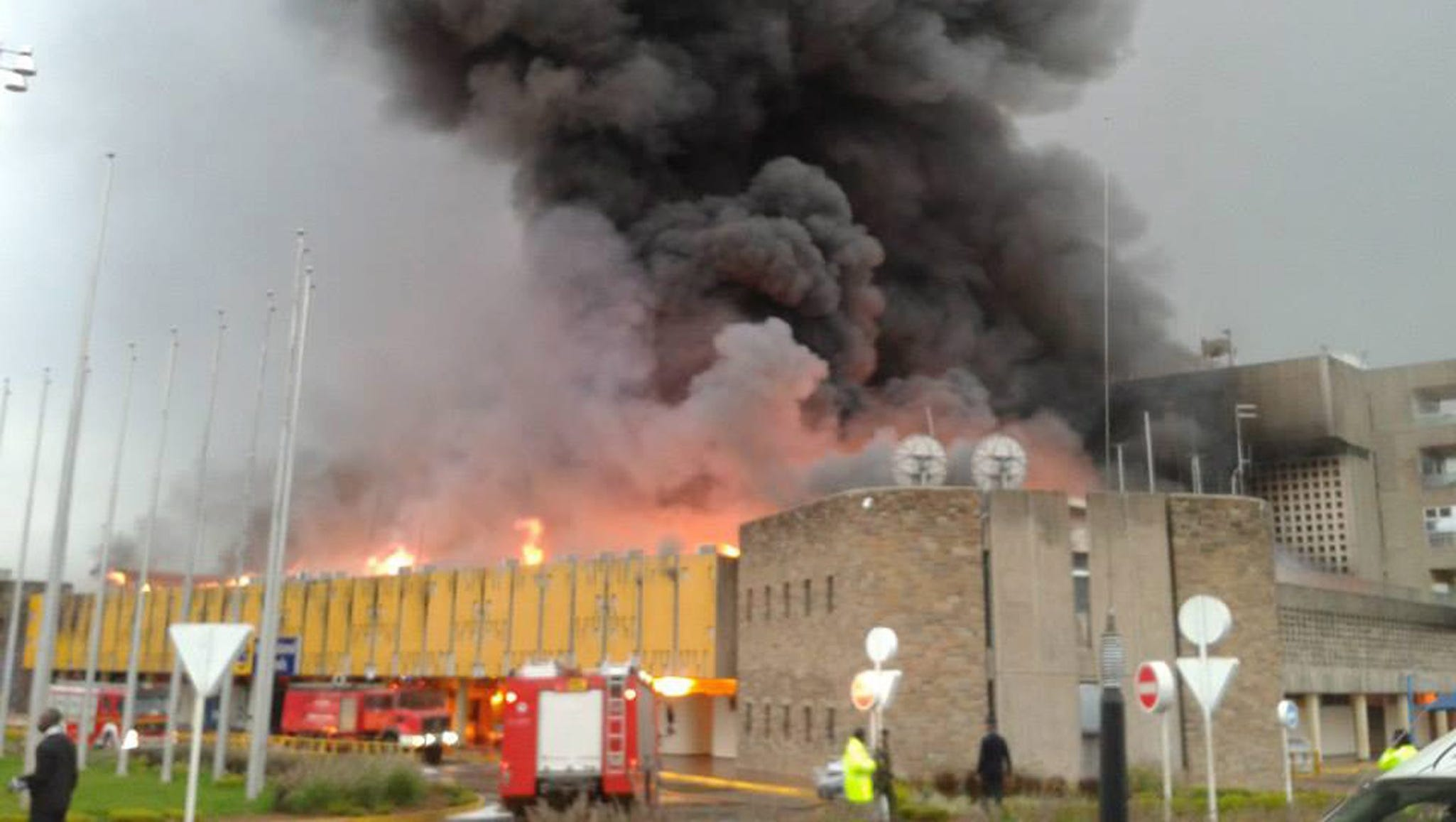 Firefighters battle a huge blaze at the Jomo Kenyatta International Airport on Aug. 7 in Nairobi, Kenya. An early morning fire engulfed the arrival hall,forcing the closure of East Africa's largest airport.