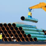 FILE - In this May 9, 2015 file photo, pipes for the proposed Dakota Access Pipeline are stacked at a staging area in Worthing, S.D. On Monday, Nov. 30, 2015, the South Dakota Public Utilities Commission is meeting to discuss whether to grant a construction permit for the 1,130-mile pipeline that would stretch from the Bakken oil fields in North Dakota through South Dakota and Iowa to a hub in Illinois. The project would move at least 450,000 barrels of crude daily from the Bakken oil patch. (AP Photo/Nati Harnik, File)