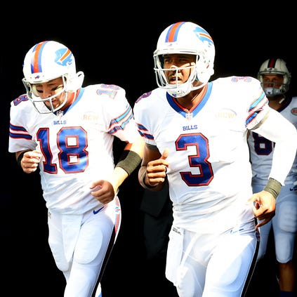 Buffalo Bills quarterback EJ Manuel (3) and quarterback Kyle Orton (18) before the game at Soldier Field.