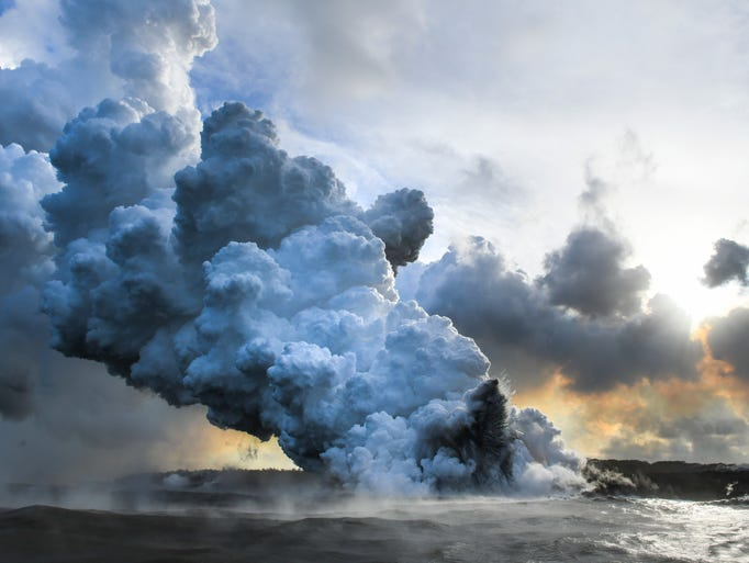 Steam rises from the entry point where lava from the