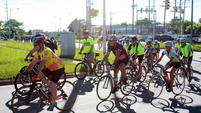 Several hundred cyclists turned out in Kalamazoo Wednesday for a ride to honor the bikers killed and hurt when a pickup truck hit them.