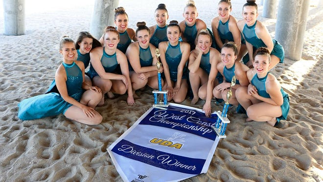 The DSU Trailblazers Competition Dance Team celebrates with their trophies after placing first in the Dance category and second in Hip Hop at the Universal Dance Association's West Coast Championship in Anaheim, Calif.