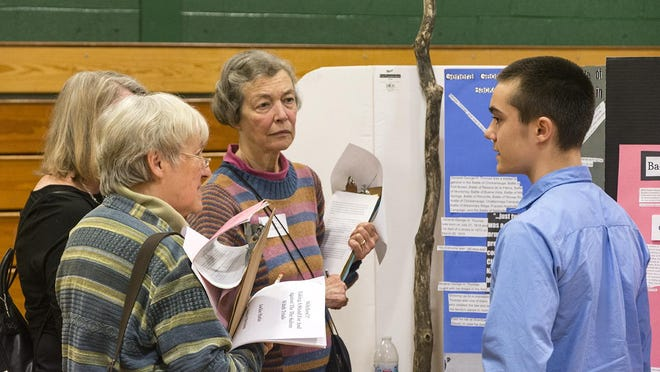A student talking about a 2017 Vermont History Day project during their judging process. Each student project is evaluated by a small group of local historians, educators and other professionals.