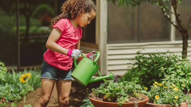 Kids can help Dad with all kinds of chores, including outdoor watering.