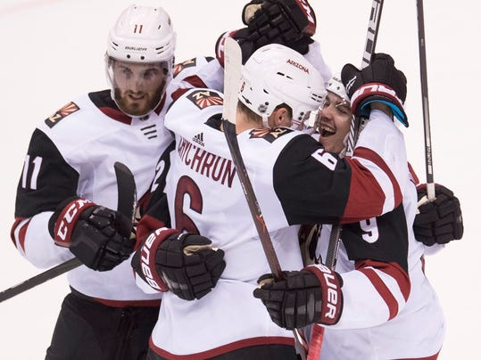 Arizona Coyotes celebrate a goal by Derek Stepan, obscured, during the third period of against the Vancouver Canucks during an NHL hockey game Wednesday, March 7, 2018, in Vancouver, British Columbia. (Jonathan Hayward/The Canadian Press via AP)