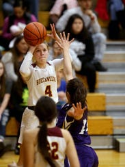 North Kitsap girls basketball player Lauren Weins plays