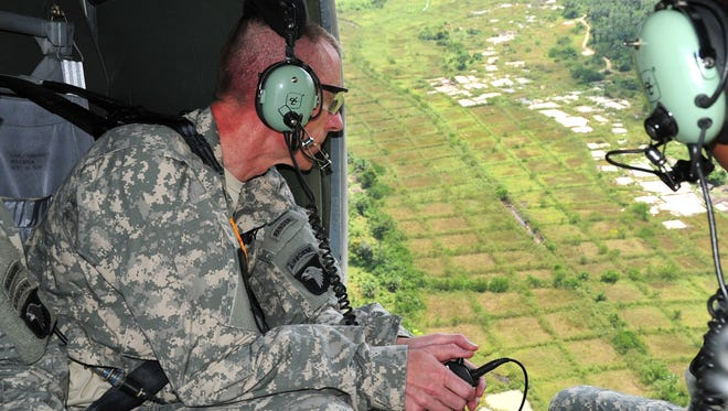Maj. Gen. Gary Volesky, commander of the 101st Airborne Division, surveys the Liberian landscape on his way to Ganta, Liberia to discuss the site of a future Ebola treatment unit. Volesky traveled with representatives from the Armed Forces of Liberia and the U.S. Agency for International Development, which is the lead agency in the U.S. government and international effort to contain Ebola in West Africa. The meeting was a success, and construction is scheduled to begin as early as this week.