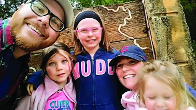 Haviland Mayor Aaron Stokes poses with his daughters, Nora, Evelyn, and Winnie, and wife Cassie at the lake in Medicine Lodge.