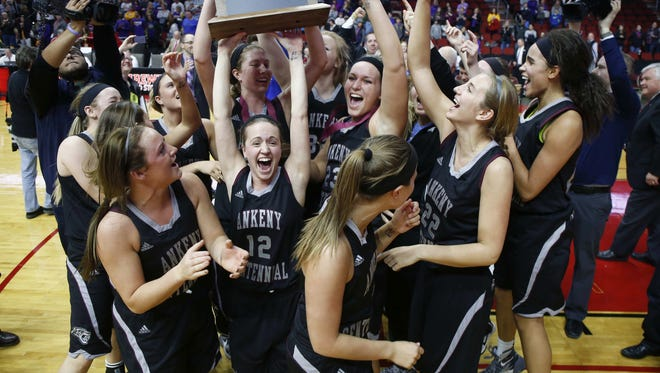 Members of the Ankeny Centennial girls basketball team celebrate after a Class 5A championship win over Johnston at Wells Fargo Arena in Des Moines on Saturday, March 5, 2016.