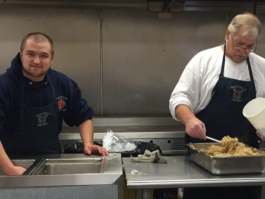Kitchen chores - FVFD Capt. Michael Loucks, left, and Bobby Glass, take on kitchen duties during the department's annual New Year's Day pork and sauerkraut dinner