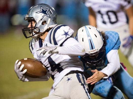 Farragut's Wyatt Lucas is grabbed by Hardin Valley's Noah Moro on Thursday, October 26, 2017.