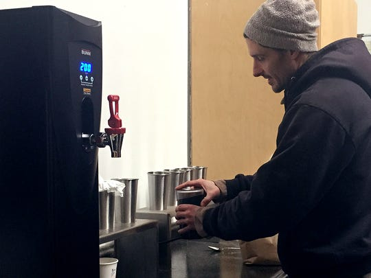 Keith Wright brews every cup of coffee and tea individually. Wright owns Rubra Atra, a new coffee shop on Pine Street.