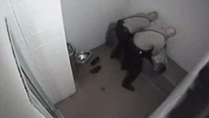 Video released by the lawyer for Aaron Henderson shows corrections officers subduing him inside the Allegan County Jail in Feb. 2014.