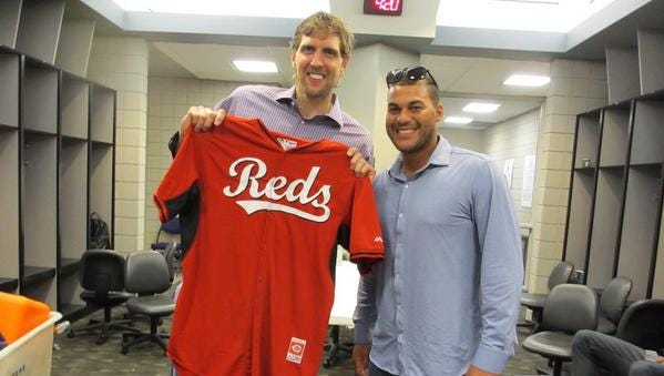 Dallas Mavericks forward Dirk Nowitzki poses with fellow German Donald Lutz, an outfielder for the Reds.
