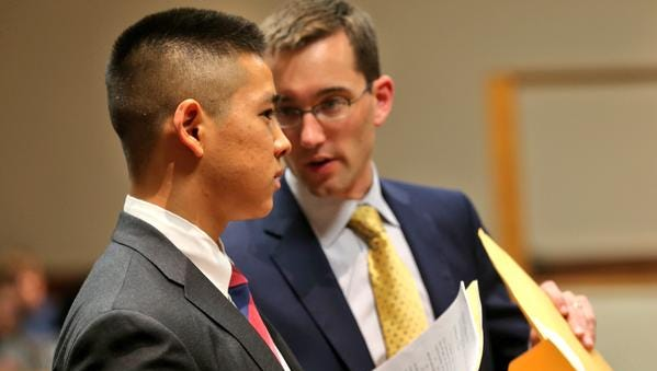 Charles Tan and defense lawyer Brian DeCarolis  in court Thursday afternoon.