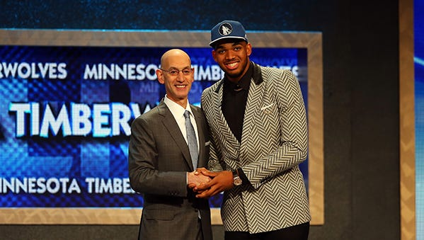 Karl-Anthony Towns poses with NBA commissioner Adam Silver after being drafted first overall by the Minnesota Timberwolves.