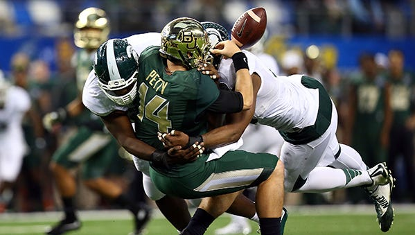 Shilique Calhoun, left, and the Spartans closed their 2014 season with a win over Baylor in the Cotton Bowl.