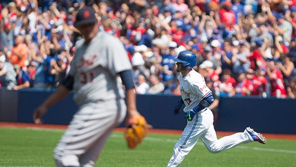 Josh Donaldson rounds the bases after hitting a solo home run off Alfredo Simon during the first inning.