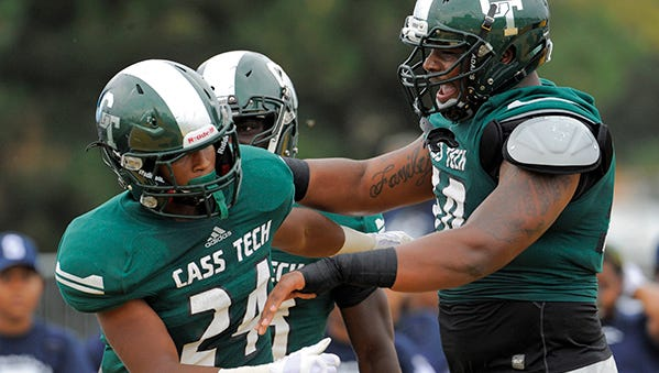 Tim Cheatham, left, and Detroit Cass Tech opened with a 27-0 win over Southfield on Saturday.