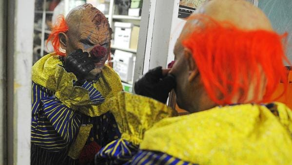 Brandon Butcher, with the Sioux Falls Jaycees Haunted House, gets his costume ready before opening night of the Haunted House Friday, Oct. 9, 2015, in the Fine Arts Building at the W.H. Lyon Fairgrounds in Sioux Falls. The Jaycees Haunted House opened Friday, and the annual haunted house brings thousands of visitors each year.