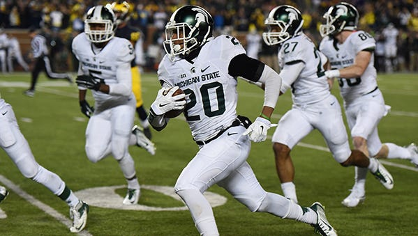 Jalen Watts-Jackson runs toward the end zone on the final play of the game against Michigan on Oct. 17 last season. It was a 38-yard return on a botched punt to give the Spartans a shocking 27-23 win.