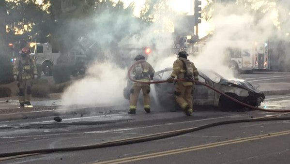 A Monday morning collision left a dump truck and car smoking and engulfed in flames.