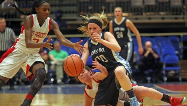 North Rockland's Jaida Patrick, left, grabs the ball after John Jay's Alana Kroner loses control in game action of the Section 1 Class AA girls basketball semifinals at the Westchester County Center in White Plains North Rockland defeated John Jay 56-45 .