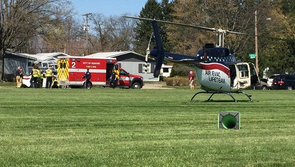 A medical helicopter waits for a patient Thursday at John Clem Elementary School.