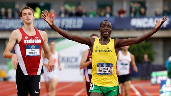 Oregon's Edward Cheserek, right, reacts after winning the men's 5,000 meters, in front of Stanford's Sean McGorty, left, at the NCAA outdoor track and field championships in Eugene, Ore., Friday, June 10, 2016. (AP Photo/Ryan Kang)